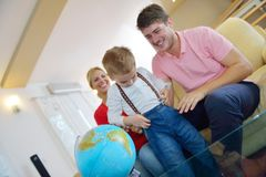 Family have fun with globe Stock Photos