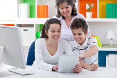 Family have fun with tablet pc Stock Photos