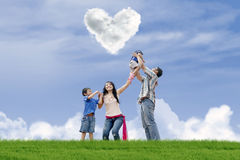 Family have fun under love clouds Royalty Free Stock Image