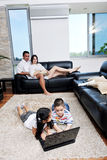 Family have fun and working on laptop at home Royalty Free Stock Photos
