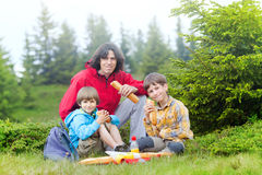 Family have got pic nic in forest. Father and two sons have got pic nic in the mountains stock images