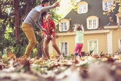 Family have play together at backyard. Smiling young parents with daughter Royalty Free Stock Images
