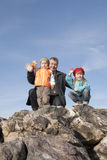 Family have a rest on a grie. Royalty Free Stock Photography