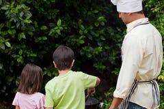 Family  having a barbecue in the garden Royalty Free Stock Photos