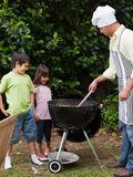 Family  having a barbecue in the garden Royalty Free Stock Images