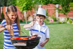 Family having barbecue Stock Images