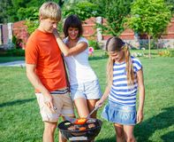 Family having barbecue Royalty Free Stock Images