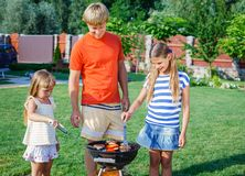 Family having barbecue Royalty Free Stock Image