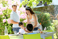 Family having barbecue lunch in garden Stock Images