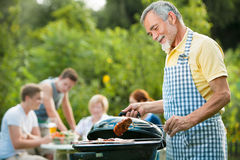 Family having a barbecue party Stock Photos