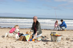 Family Having Barbeque On Winter Beach Royalty Free Stock Images