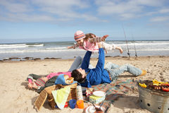 Family Having Barbeque On Winter Beach Royalty Free Stock Image