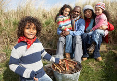 Family Having Barbeque On Winter Beach Royalty Free Stock Photo