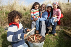 Family Having Barbeque On Winter Beach Stock Image