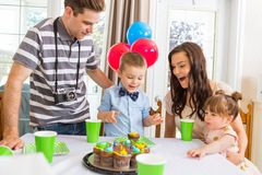 Family Having Birthday Party. Boy with family celebrating birthday party at home Stock Photography