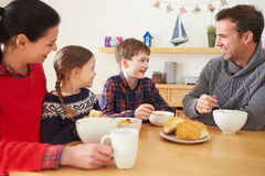 Family Having A Bowl Of Soup For Lunch Royalty Free Stock Image