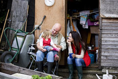 A family having a break on an allotment Stock Photography