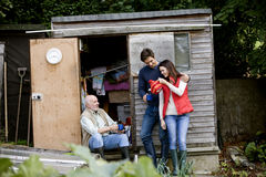 A family having a break on an allotment, drinking tea Stock Photo