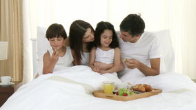 Family having breakfast in bed Royalty Free Stock Image