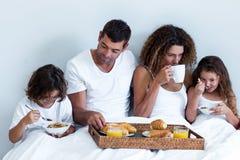 Family having breakfast in bed Royalty Free Stock Photos