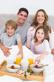 Family having breakfast in bed Royalty Free Stock Images