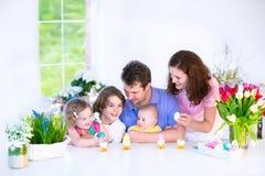 Family having breakfast on Easter day Stock Photo