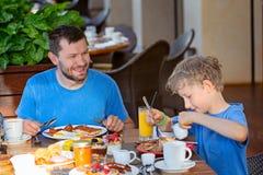 Family having breakfast royalty free stock photo