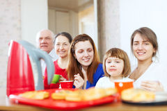 Family having breakfast at home Stock Images