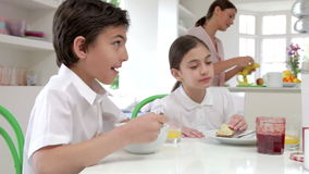 Family Having Breakfast Before Husband Goes To Work stock footage