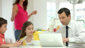Family Having Breakfast Before Husband Goes To Work stock video footage