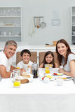 Family having breakfast in the kitchen Stock Photos