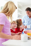 Family Having Breakfast In Kitchen Before School stock images