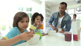 Family Having Breakfast In Kitchen Together stock video