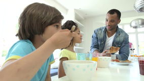 Family Having Breakfast In Kitchen Together stock footage