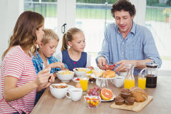 Family having breakfast at table Royalty Free Stock Photography
