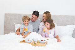 Family having breakfast together in bed Royalty Free Stock Photo