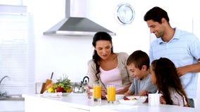 Family having breakfast together stock video