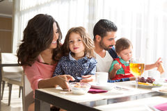 Family having breakfast Royalty Free Stock Images