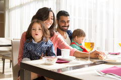 Family having breakfast. Young latin family having breakfast with kids Royalty Free Stock Images