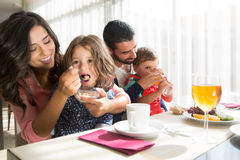 Family having breakfast. Young latin family having breakfast with kids Stock Photo
