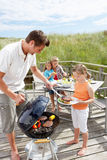 Family having burgers off the grill. Out in the sun royalty free stock photo