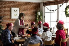 Family having a Christmas dinner Royalty Free Stock Photography