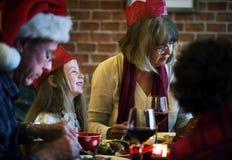 Family having a Christmas dinner Stock Photo