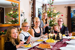 Family having Christmas dinner sausages Stock Photos