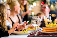 Family having Christmas dinner sausages Stock Photography
