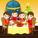 Family having christmas dinner together Royalty Free Stock Photo