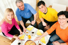 Family having coffee and cake together royalty free stock image