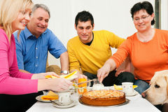 Family having coffee and cake together Stock Photos