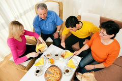 Family having coffee and cake together Royalty Free Stock Photo