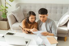 Free Family Having Conflict Fight About Wasting Money Financial Problem At Home Stock Image - 181890711